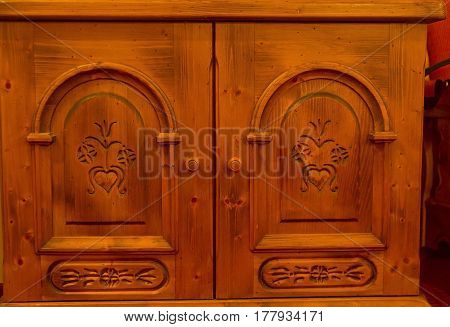 Carved ornaments on the doors of the old closet. Interior of the hotel in Tyrol Austria.