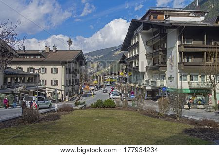 MAYRHOFEN AUSTRIA - MARCH 10 2017: The central street of Mayrhofen - a ski resort in the Austrian Alps. Sunny day in March.