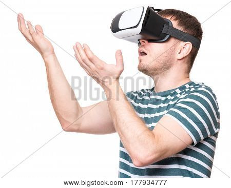 Amazed handsome man wearing virtual reality goggles watching movies or playing video games gesticulating hands. Surprised male looking in VR glasses. People experiencing 3D gadget technology.