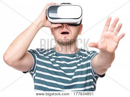Amazed man wearing virtual reality goggles watching movies or playing video games, isolated on white background. Surprised male looking in VR glasses. People experiencing 3D gadget technology.