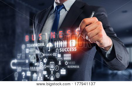 Businessman sketching his ideas . Mixed media