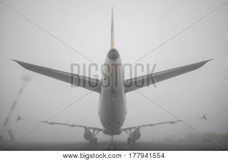 the plane in the fog on the Runway