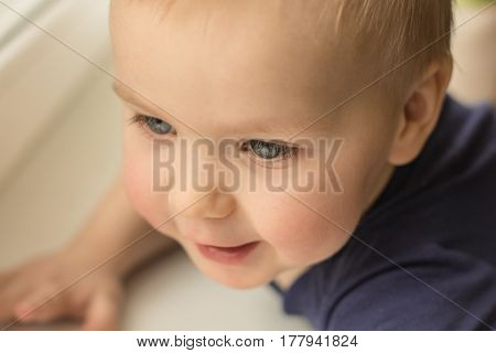 Top view of a beautiful happy little Caucasian boy (white) with blue eyes 2-3 years close-up portrait