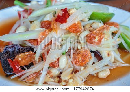 Closeup to Famous Thai food, papaya salad or SOM TAM or Somtum.