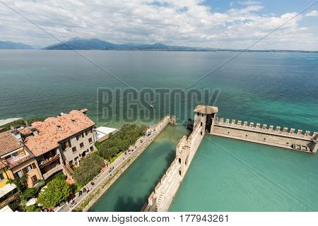 SIRMIONE ITALY - MAY 5 2016: Backwater inside the Scaliger Castle - medieval port fortress Sirmione Italy