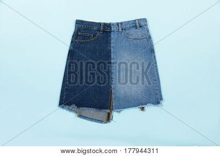 Blue denim skirt isolated on blue background