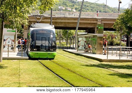 Tram green transportation stopped at a station waiting for passengers. Bilbao Spain. Photo taken on: May 23rd 2010 Bilbao Spain