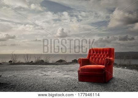 lost armchair in the beach