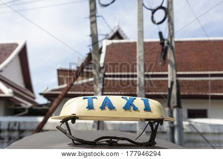 taxi cab on top of tuk tuk car in background of temple Bangkok Thailand. tuk tuk is tradition taxi of thailand