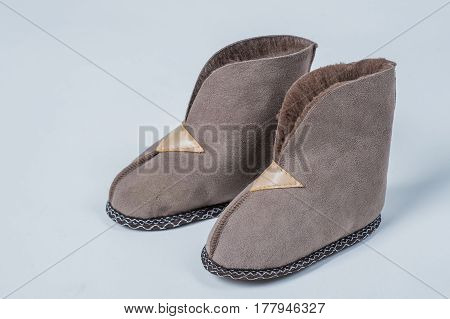 Natural slippers for a home wool on a white background