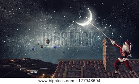 Santa catch the moon . Mixed media