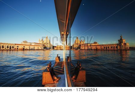 View And Reflection In The Glass Of The Old Cathedral Of Santa Maria Della Salute At Sunset In Venic