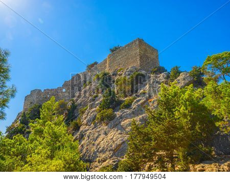 The Castle of Monolithos on the high cliff, Rhodes island, Greece.
