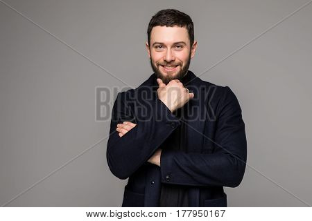 Young Businessman Thinking Of Idea On Grey