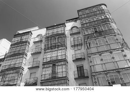 Jaen (Andalucia Spain): facade of building with typical verandas. Black and white