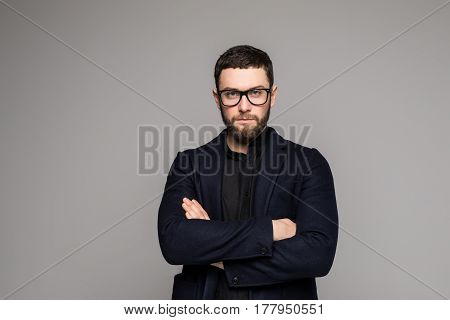 Businessman In Suit With Arms Crossed