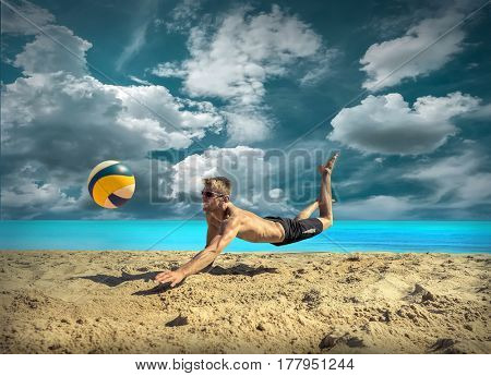 Beach Volleyball player in sunglasses under sunlight. Dynamic sport action outdoor.