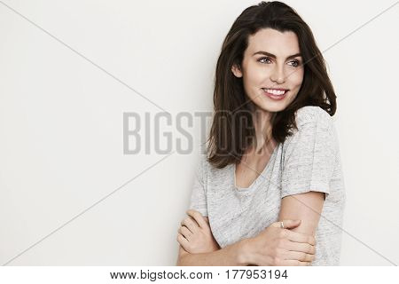 Cute Smiling brunette looking away studio shot