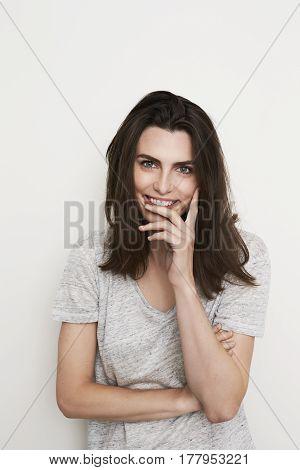 Gorgeous brunette girl smiling ins studio shot
