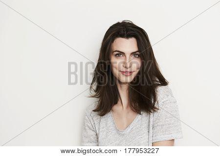 Beautiful brunette woman smiling portrait studio shot