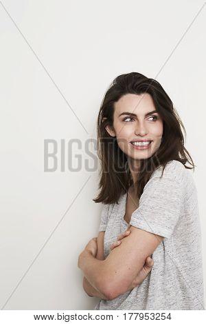 Beautiful woman in grey t-shirt looking away