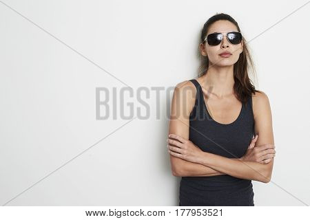 Cool attitude girl in vest and shades portrait