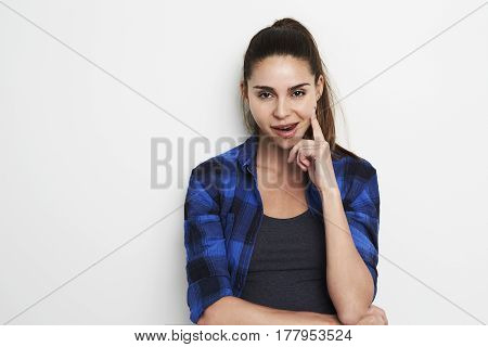 Beautiful woman in blue checked shirt portrait