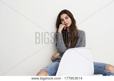 Relaxing beautiful woman in studio portrait studio