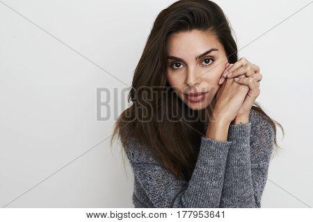 Gorgeous brown eyed brunette in studio portrait