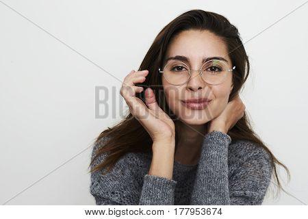Cheeky Beautiful brunette in spectacles portrait studio
