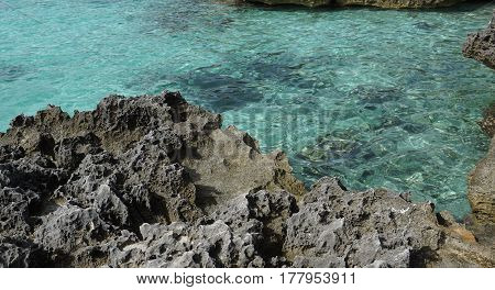 Rocky beach with crystal clear water in Menorca
