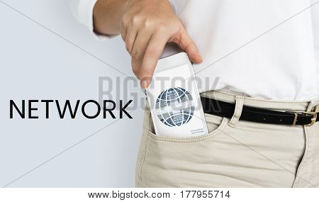 Man putting cellphone into his trouser pocket