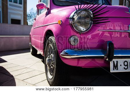 MALAGA, SPAIN - FEBRUARY 28, 2017: Retro Málaga IV. A pink Seat 600 with eyelashes in the International outdoor exhibition of classic vintage cars.