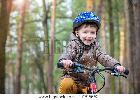 Happy Kid Boy Of 3 Or 5 Years Having Fun In Autumn Forest With A
