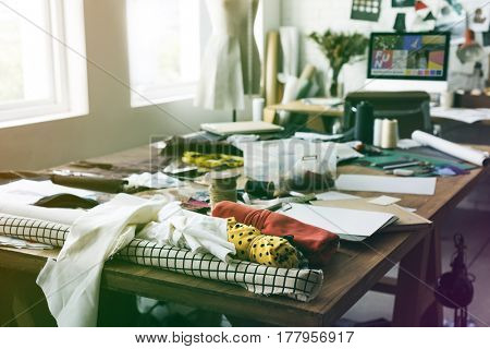 Fashion design messy workspace on wooden table
