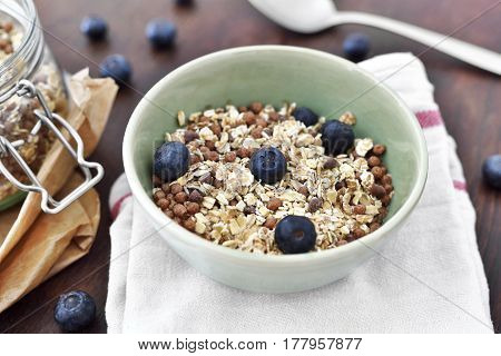 Delicious cereal breakfast with bowl and fresh fruits. Fresh blueberry fruits, healthy eating scene.