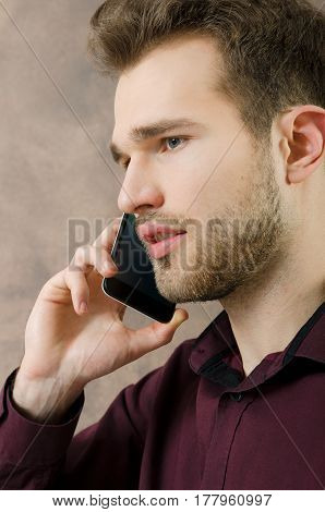 Handsome man talking on the phone copyspace. phone man talking call mobile calling business young concept