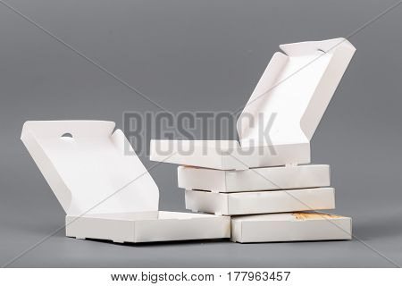 Pizza Boxes On A Gray Background. Isolate