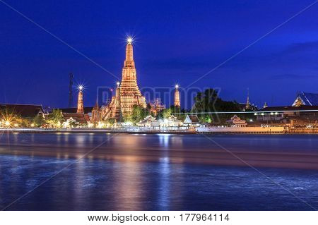 Wat Arun Temple in twilight time located near Chao Phraya River famous tourist attraction of Bangkok Thailand