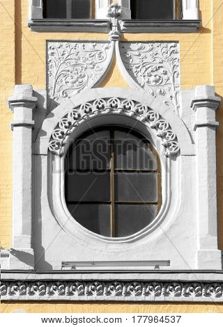 Beautiful wooden window with ornate wall background