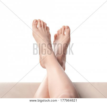 Legs of young woman taking rest, on white background