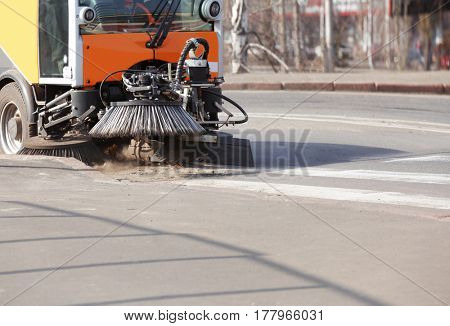 Municipal car for cleaning roads and sidewalks outdoors
