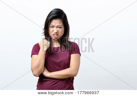 Angry Young Chinese Woman Snarling At The Camera