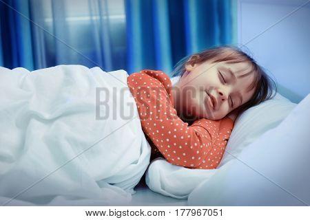 Little cute girl sleeping in bed