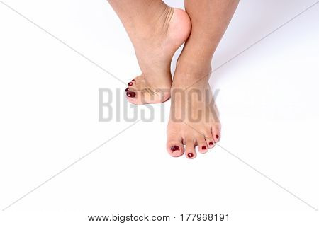 Beauty Concept Of Red Painted Toenails