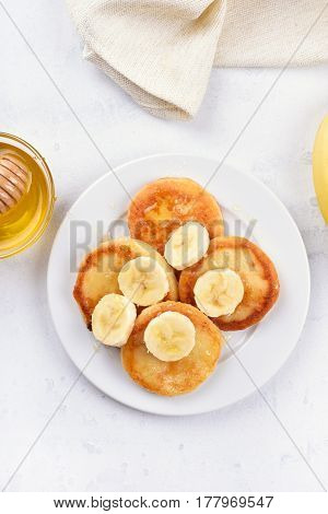 Fritters cottage cheese pancakes with banana slices healthy breakfast top view