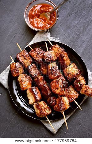 Homemade grilled pork skewers on wooden table top view