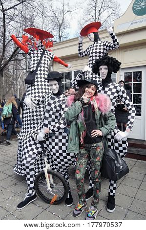 MOSCOW - MARCH 18, 2017: Saint Patrick's Day celebration in Moscow. Street actors pose for photos in Sokolniki park. Color photo.