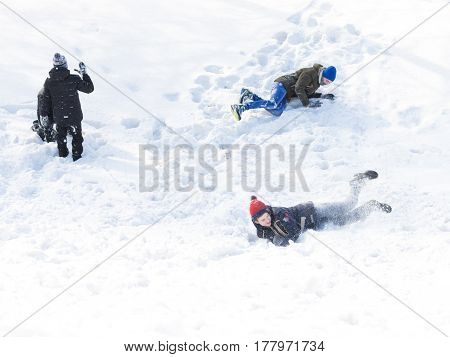 Vladimir -12 February 2017: Happy children play and lie in the snow on a winter day February 12 2017 Vladimir Vladimir Region Russia