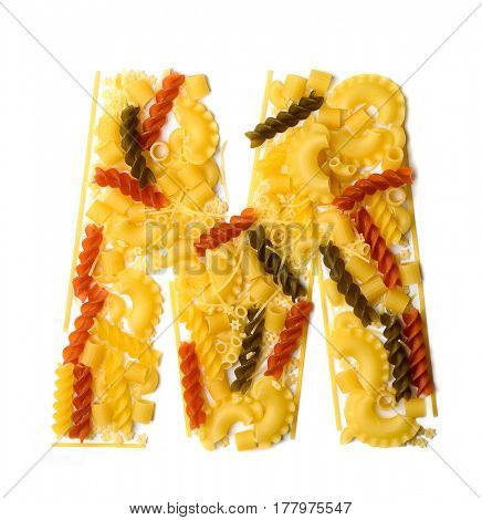 Pile of spaghetti forming a letter M, all different shapes, colors and varieties